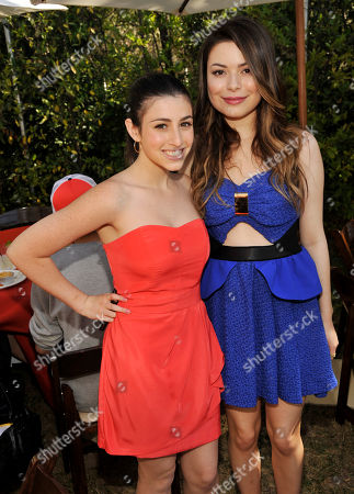 """Dana Gaier, left, and Miranda Cosgrove, cast members in """"Despicable Me 2,"""" pose together at the post-premiere party for the film at Universal Citywalk on in Universal City, Calif"""