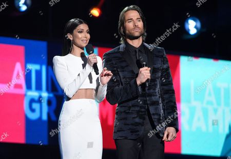 Hosts Roselyn Sanchez, left, and Sebastian Rulli speak on stage at the 17th annual Latin Grammy Awards at the T-Mobile Arena, in Las Vegas