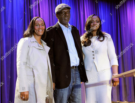"""Donna Houston, left, sister-in-law of the late singer Whitney Houston, Gary Houston, center, brother of Whitney, and Gary's wife Pat Houston pose together at the media preview day for the """"Whitney! Celebrating the Musical Legend of Whitney Houston"""" exhibit at The Grammy Museum, in Los Angeles"""
