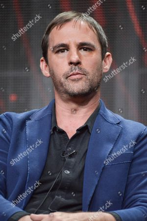 "Roberto Orci speaks onstage during the ""The Directors Chair"" segment of the El Rey Network 2014 Summer TCA, in Beverly Hills, Calif"
