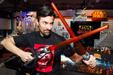 Stock Image of IMAGE DISTRIBUTED FOR HASBRO - Jeff Wolf demonstrates the new STAR WARS REBELS INQUISITOR LIGHTSABER in the Hasbro, Inc. showroom during the American International Toy Fair on in New York. The signature weapon of the fearsome new villain from the upcoming new animated series features three ways to play - single blade, double blade or with the FORCE DISC launcher. The LIGHTSABER will be available in fall 2014