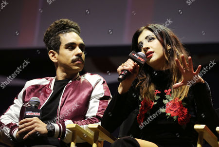 "Ray Santiago, left, and Dana DeLorenzo are seen onstage during the panel for the STARZ Original Series ""Ash vs. Evil Dead"" at New York Comic Con on in New York"