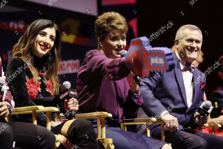 "Dana DeLorenzo, left, Lucy Lawless, center, and Bruce Campbell are seen onstage during the panel for the STARZ Original Series ""Ash vs. Evil Dead"" at New York Comic Con on in New York"