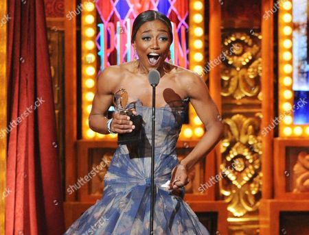 """Patina Miller accepting her Tony Award for best actress in a musical for her role in """"Pippin"""" at the 67th Annual Tony Awards in New York. Six alumni from Carnegie Mellon University took home Tonys in five categories, a glittery haul that was both a school record and a huge source of pride for a theater department that turns 100 next year. Billy Porter, Patina Miller and Judith Light each took home acting Tonys, while Ann Roth got one for best costume design, and partners Jules Fisher and Peggy Eisenhauer won for best lighting design of a play"""