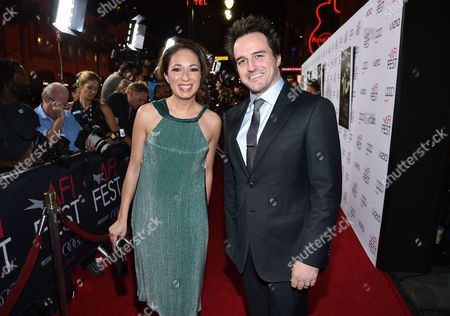 """Producers Anna Gerb, left, and Neil Dodson arrive at 2014 AFI Fest - """"A Most Violent Year"""" at the Dolby Theatre, in Los Angeles"""