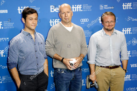 """Joseph Gordon-Levitt, Bruce Willis and Director Rian Johnson participate in a photo call and press conference for the film """"Looper"""" during the 2012 Toronto International Film Festival at the TIFF Bell Lightbox on in Toronto"""