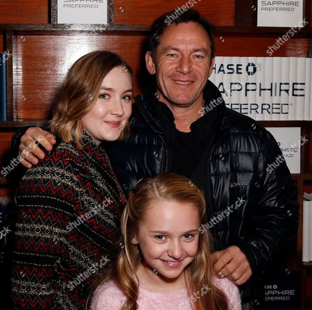 "JCast members Jason Isaacs, Saoirse Ronan and Avery Phillips from the film ""Stockholm, Pennsylvania"" smile at the Indiewire Photo Studio at Chase Sapphire on Main during the 2015 Sundance Film Festival, in Park City, Utah"