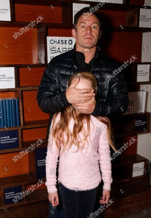 "JCast members Jason Isaacs and Avery Phillips from the film ""Stockholm, Pennsylvania"" play around at the Indiewire Photo Studio at Chase Sapphire on Main during the 2015 Sundance Film Festival, in Park City, Utah"