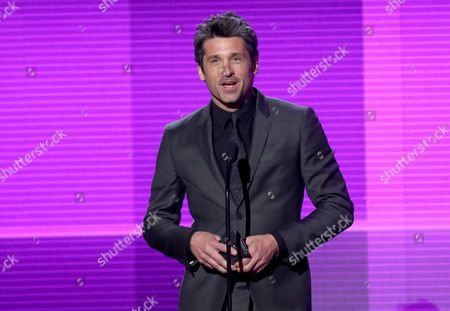 """Patrick Dempsey presents the award for pop/rock band, duo or group on stage at the 42nd annual American Music Awards in Los Angeles. In the, episode of """"Grey's Anatomy"""" Dempsey made a surprise departure from the series, when his character Derek """"McDreamy"""" Shepherd died from injuries suffered when he was blindsided by a truck. ABC President Paul Lee was asked Tuesday, Aug. 4, about the decision to kill off Dempsey's character, Derek """"McDreamy"""" Shepherd from the show. The question was asked at a bi-annual press conference for TV critics. Lee went on to say that 'It was a difficult decision. Patrick obviously has lots of interests outside. He's very big in motosport. Shonda (Rhimes) decided that was the way to go.â"""
