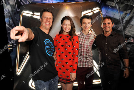 """Gavin Hood, far left, director of the forthcoming film """"Ender's Game,"""" poses with, left to right, cast members Hailee Steinfeld and Asa Butterfield and producer Bob Orci at a preview event for the film at the 2013 Comic-Con International Convention on in San Diego, Calif"""