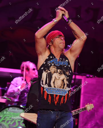 SUNRISE, FL - AUGUST 9: Bret Michaels and Rikki Rockett of Poison perform during the Rock of Ages Tour 2012 at the Bank Atlantic Center on in Sunrise, Florida