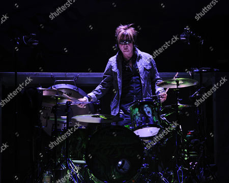 SUNRISE, FL - AUGUST 9: Rikki Rockett of Poison performs during the Rock of Ages Tour 2012 at the Bank Atlantic Center on in Sunrise, Florida