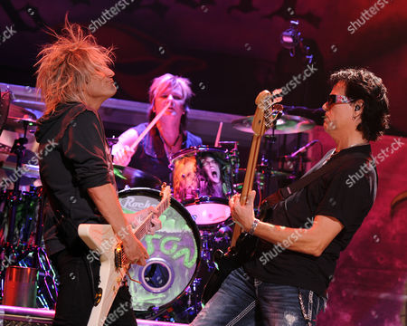 SUNRISE, FL - AUGUST 9: C.C. DeVille, Rikki Rockett and Bobby Dall of Poison perform during the Rock of Ages Tour 2012 at the Bank Atlantic Center on in Sunrise, Florida