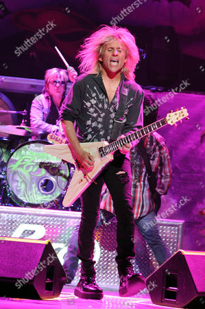 SUNRISE, FL - AUGUST 9: C.C. DeVille and Rikki Rockett of Poison perform during the Rock of Ages Tour 2012 at the Bank Atlantic Center on in Sunrise, Florida