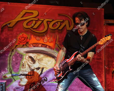 SUNRISE, FL - AUGUST 9: Bobby Dall of Poison performs during the Rock of Ages Tour 2012 at the Bank Atlantic Center on in Sunrise, Florida