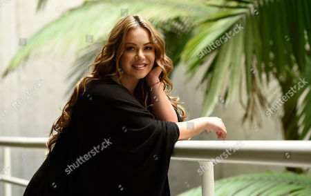 "Singer and television personality Janney ""Chiquis"" Rivera poses for a portrait in Los Angeles. Rivera, the daughter of the late Jenni Rivera, is promoting Jenni Rivera: Unforgettable, Baby!,"" a photo book that for the first time shows a picture of Fernando, Jenni Rivera's on and off boyfriend for about 10 years. The book was edited by The Jenni Rivera Estate and published by Atria Books on October 27"