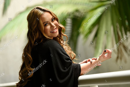 "Singer and television personality Janney ""Chiquis"" Rivera poses for a portrait in Los Angeles. Rivera, the daughter of the late Jenni Rivera, is promoting â?œJenni Rivera: Unforgettable, Baby!,"" a photo book that for the first time shows a picture of Fernando, Jenni Riveraâ?™s on and off boyfriend for about 10 years. The book was edited by The Jenni Rivera Estate and published by Atria Books on October 27"