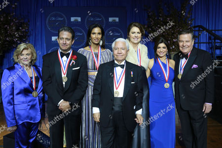 I. Lorraine Thomas, philanthropist and co-founder of The Dave Thomas Foundation for Adoption, Bill Evans, meteorologist of WABC-TV New York, Padma Lakshmi, TV host, Nasser J. Kazeminy, Chairman of the National Ethnic Coalition of Organizations, Ali Torre, co-founder of the Joe Torre Safe At Home Foundation, Tamsen Fadal, News Anchor and Marvin Scott, News Anchor, attend the National Ethnic Coalition of Organization's 2016 Ellis Island Medals of Honor awards ceremony on on Ellis Island, NY
