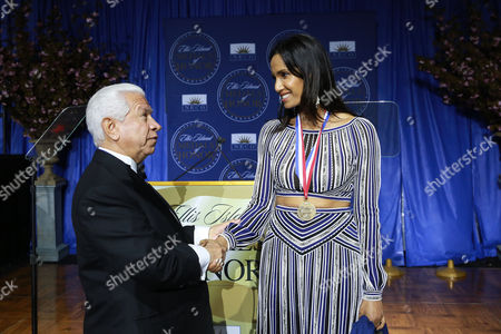 Nasser J. Kazeminy, Chairman of the National Ethnic Coalition of Organizations congratulates Padma Lakshmi, TV host, as a 2016 Ellis Island Medals of Honor recipient at the 2016 Ellis Island Medals of Honor awards ceremony on on Ellis Island, NY. NECO honored ninety outstanding Americans including Joint Chiefs of Staff General Martin Dempsey, former U.S Army General Ann E. Dunwoody, recording artist Tony Orlando, former Sandy Hook first grade teacher, Kaitlin Roig-DeBellis and former NFL player Mike Utley