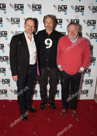 From left, Producer Kim Magnusson, Actor Mads Mikkelsen, and Producer Tivi Magnusson pose for photographers upon arrival at a screening of the film Men And Chicken, showing as part of the London Film Festival, in central London