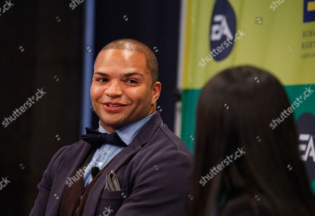 NFL linebacker and Super Bowl Champion Brendon Ayanbadejo of the Baltimore Ravens gets interviewed by Maya Harris from the Ford Foundation at Electronic Arts' LGBT Full Spectrum Event on Thursday, March, 7, 2013 in New York City, New York
