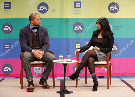 IMAGE DISTRIBUTED FOR EA - NFL linebacker and Super Bowl Champion Brendon Ayanbadejo of the Baltimore Ravens gets interviewed by Maya Harris from the Ford Foundation at Electronic Arts' LGBT Full Spectrum Event on Thursday, March, 7, 2013 in New York City, New York