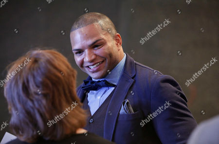 NFL linebacker and Super Bowl Champion Brendon Ayanbadejo of the Baltimore Ravens speaks with guest at Electronic Arts' LGBT Full Spectrum Event on Thursday, March, 7, 2013 in New York City, New York