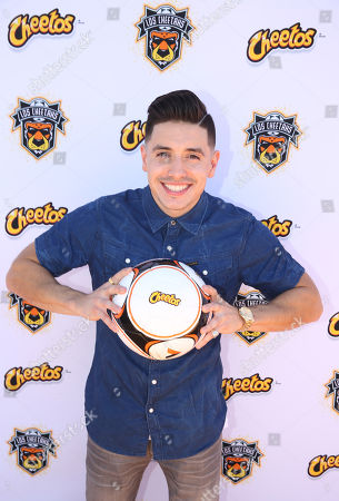 Stock Photo of Recording artist and former American Idol finalist Stefano Langone joins the masters of mischief, the Cheetos brand, to celebrate the worldwide premiere of Los Cheetahs, a new trick fútbol team, with the singing of the National Anthem, in Long Beach, Calif