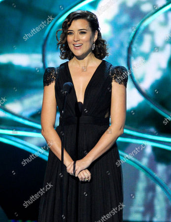 """Cote de Pablo introduces a performance by Fall Out Boy at the People's Choice Awards at the Nokia Theatre in Los Angeles. de Pablo isn't coming back to """"NCIS,"""" but close. The actress, who is starring in CBS' """"The Dovekeepers,"""" looked surprised to hear that the two-part movie is scheduled to debut after the crime drama in which she played government agent Ziva David. """"Really?"""" de Pablo exclaimed after executive producer Roma Downey told the Television Critics Association about the March 31, 2015 scheduling"""