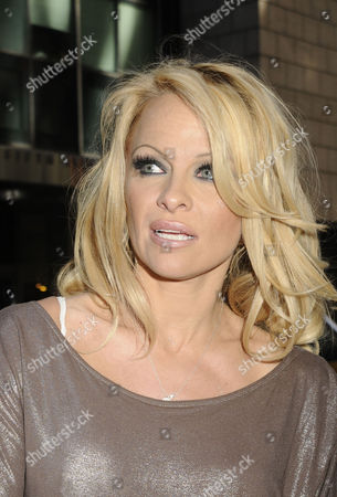 New York Ny - April 30: Pam Anderson Attends the Horse-drawn Carriage Industry Protest On the Streets of Manhattan On April 30 2011 in New York City People: Pam Anderson United States of America Manhattan