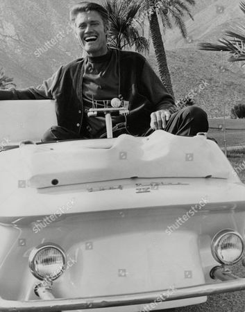 American Actor Chuck Connors On A Golf Cart At Canyon Country Golf Club Palm Springs. Box 757 418051738 A.jpg.