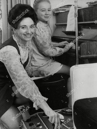 Stock Photo of Alma Cook With Her Daughter Diane (8). Alma Writes The Songs And Diane Plays Them On The Piano. Box 758 522051745 A.jpg.