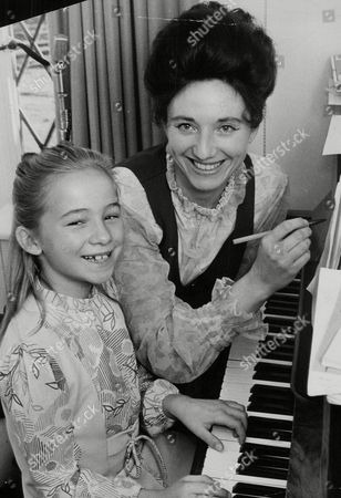 Editorial picture of Alma Cook With Her Daughter Diane (8). Alma Writes The Songs And Diane Plays Them On The Piano. Box 758 522051746 A.jpg.