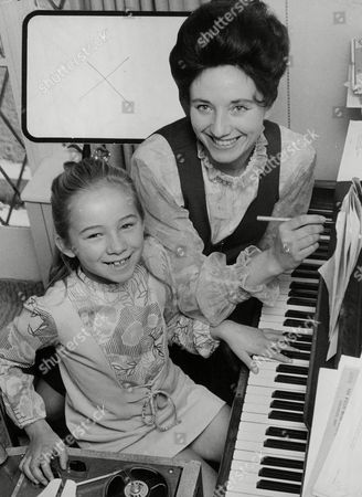 Stock Picture of Alma Cook With Her Daughter Diane (8). Alma Writes The Songs And Diane Plays Them On The Piano. Box 758 522051744 A.jpg.