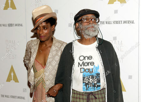 "Screenwriter Joie Lee, left, and father Bill Lee, right, attend a screening of ""Do The Right Thing"" at BAMcinemaFest 2014, in New York"