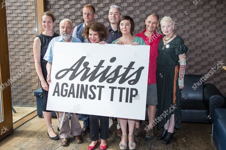 From left, Carrie Cracknell, Mike Leigh, Nick Dearden, Helen McCrory, John Hilary, Vicky Featherstone, Mark Rylance and Dame Vivienne Westwood pose for photographers during a photocall for the launch of Artists Against the Transatlantic Trade and Investment Partnership (TTIP) at the Young Vic Theatre in London, Britain