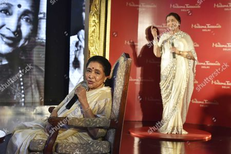 Legendary singer Asha Bhosle during an unveiling of her wax figure at the Madame Tussauds museum, on October 3, 2017 in New Delhi, India.