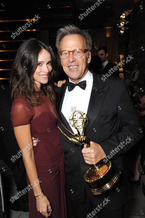 Abigail Spencer, left, and producer Mark Johnson attend the AMC, IFC, Sundance Channel Emmy After Party, on in West Hollywood, Calif