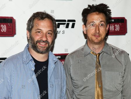 """Judd Apatow, left, and Michael Bonfiglio, right, attend the premiere of ESPN Film's """"Doc & Darryl"""" at The Joseph Urban Theater, in New York"""