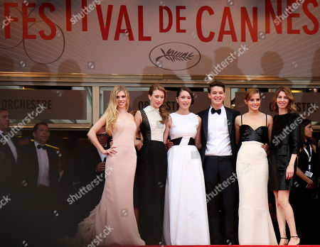 From left, actors Claire Julien, Taissa Fariga, Katie Chang, Israel Broussard, Emma Watson, and director Sofia Coppola pose for photographers as they arrive for the screening of Young & Beautiful at the 66th international film festival, in Cannes, southern France
