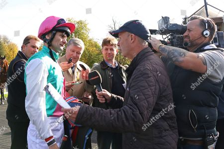 Robert Havlin is interviewed by Luke Harvey and the press after his winning comeback ride on Purser at Lingfield