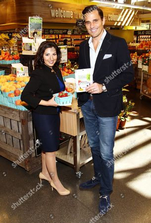 Stock Picture of IMAGE DISTRIBUTED FOR INTUIT - Kavita Shukla, left, owner of FreshPaper, and Bill Rancic, Intuit QuickBooks spokesperson, pose for a photo at Intuit's QuickBooks Small Business Big Game Top 10 Regional Tour at Whole Foods, in Columbia, MD