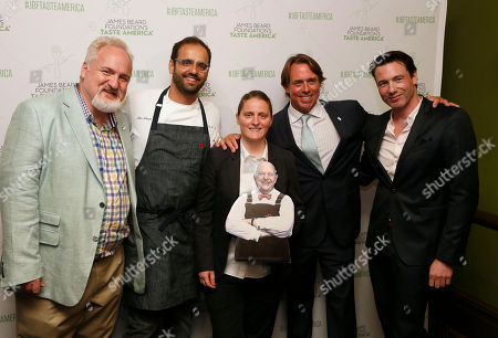 Stock Photo of James Beard All-Star Chefs, from left to right, Art Smith, Alon Shaya, April Bloomfield, John Besh and Rocco DiSpirito, are photographed with a picture of James Beard at the kick-off event for the James Beard Foundation's Taste America national epicurean tour, presented in association with the Ritz-Carlton Rewards Credit Card at the James Beard House in New York, N.Y
