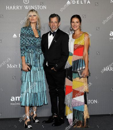 Karolina Kurkova, left, amfAR Chairman Kenneth Cole, center, and Margherita Missoni pose for photographers as they arrive for the amfAR charity dinner during the fashion week in Milan, Italy