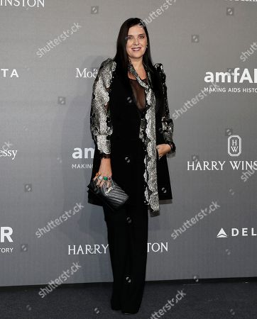Gisella Marengo poses for photographers as she arrives for the amfAR charity dinner during the fashion week in Milan, Italy