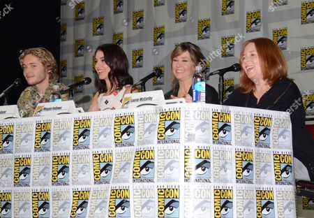 "Toby Regbo and from left, Adelaide Kane, Megan Follows and Laurie McCarthy attend the ""Reign"" panel on Day 1 of Comic-Con International, in San Diego"