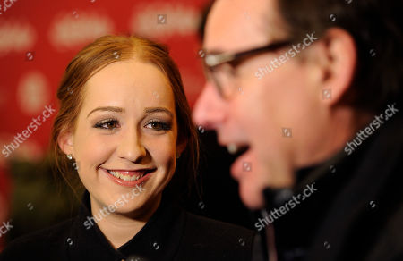 """Eleanor Columbus, left, co-executive producer of """"Little Accidents,"""" looks over at her father Chris Columbus, also an executive producer of the film, as they are interviewed together at the premiere of the film during the 2014 Sundance Film Festival, in Park City, Utah"""