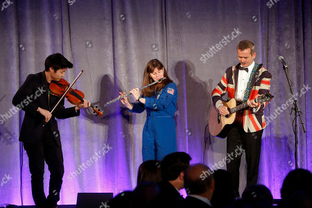 "From left, violinist Charles Yang and astronauts Chris Hadfield and Cady Coleman perform onstage at the Liberty Science Center Genius Gala 4.0 where Jeff Bezos, Founder and Chairman of Amazon, Vinton Cerf, Chief Internet Evangelist at Google and Father of the internet, and Jill Tarter, astronomer and SETI researcher of ""Contact"" fame, are honored on Fri., in Jersey City, N.J. The gala, hosted by Center President Paul Hoffman, also pays tribute to former NJ Governor Tom Kean on his 80th birthday and features a special performance by magician/ illusionist David Blaine, and raises funds to support the Center's vast array of exhibitions, educational programs, and community initiatives"
