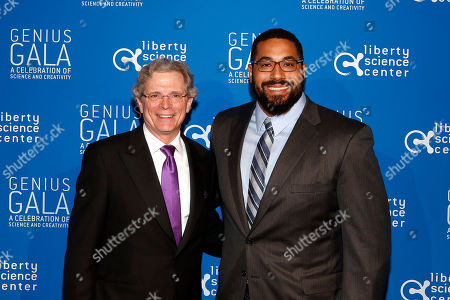 "Gala Co-chair John Strangfeld, left, and Mathematician John Urschel, lineman of the Baltimore Ravens attend the Liberty Science Center Genius Gala 4.0 where Jeff Bezos, Founder and Chairman of Amazon, Vinton Cerf, Chief Internet Evangelist at Google and Father of the internet, and Jill Tarter, astronomer and SETI researcher of ""Contact"" fame, are honored on Fri., in Jersey City, N.J. The gala, hosted by Center President Paul Hoffman, also pays tribute to former NJ Governor Tom Kean on his 80th birthday and features a special performance by magician/ illusionist David Blaine, and raises funds to support the Center's vast array of exhibitions, educational programs, and community initiatives"