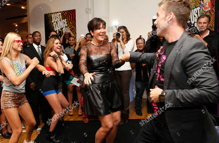 Kris Jenner and Lance Bass play the Just Dance 4 video game at the Just Dance 4 Fashion Show, in New York